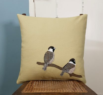 Two Sparrows sitting on a branch applique pale yellow cotton cushion