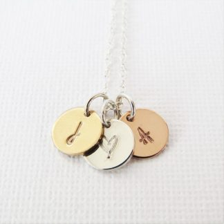 hand stamped mixed metals initial disc necklace