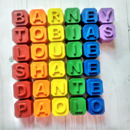 Personalised wax crayon names in rainbow colours