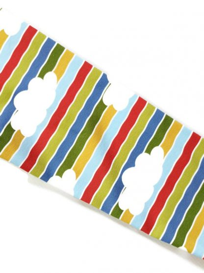Colour blocked childrens clothes with cloud and stripe print sleeves.