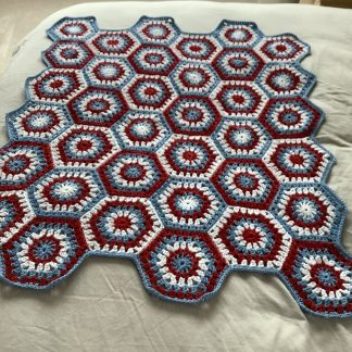 Red white and blue hexagon lap blanket