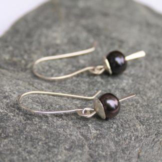 Long silver peacock pearl earrings by Thistledown Wishes