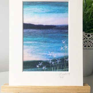 Mounted print of Scottish Wool Art coastal landscape with daisies