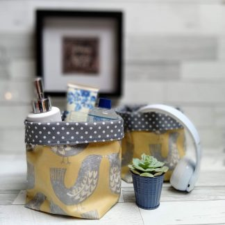 two scandi bird storage baskets