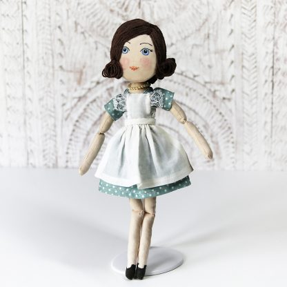 Full-length 1950s housewife doll standing