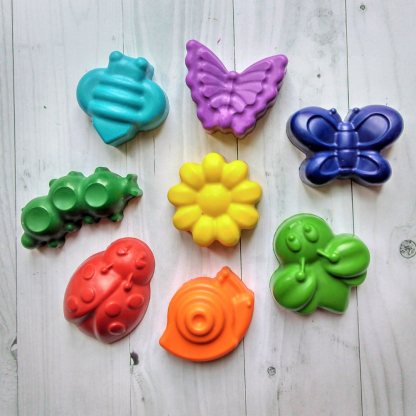 rainbow coloured crayons in the shape of garden bugs