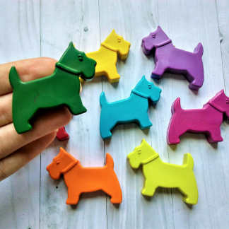 Scottie dog shaped wax crayons in rainbow colours
