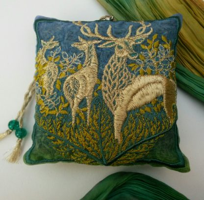 A Lavender Bag with embroidered design on the front of a woodland scene in spring green foliage and colours shows a Stag with two hinds next to him.