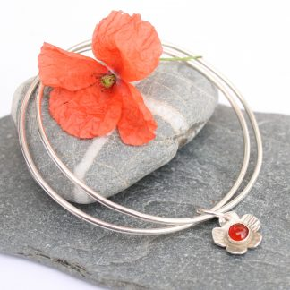 Silver bangles with flower charm by Thistledown Wishes