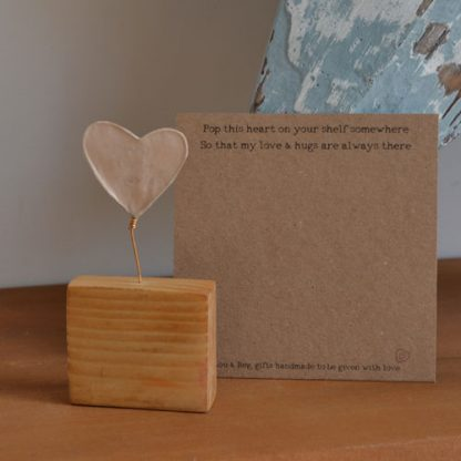 Wooden Block with wire heart to the top with the words Love & hugs always to you from me to the front