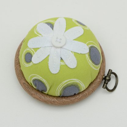 Flower pincushion in abstract dot lime green fabric