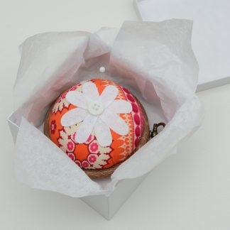 Flower pin cushion in funky orange and pink fabric