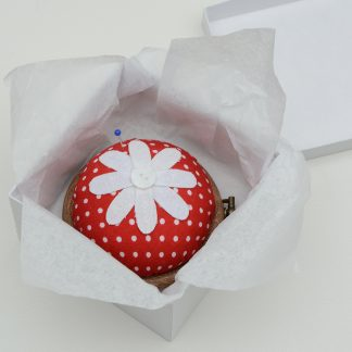 Flower pincushion in red polkadot fabric