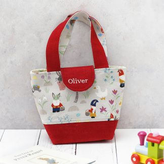 Child's red tote bag in egg hunt fabric and name personalisation