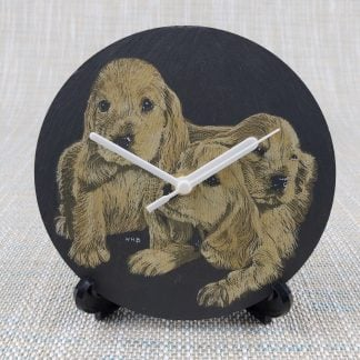 Painted spaniels slate disc converted into a clock