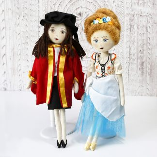2 special occasion keepsake dolls in different costumes