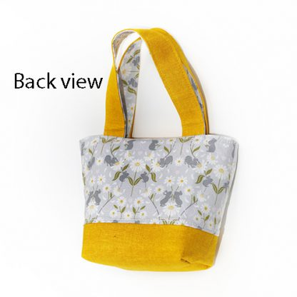 Back view of yellow toy tote bag