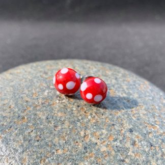 red spotty stud earrings