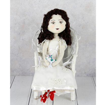 Bride keepsake doll sitting on chair