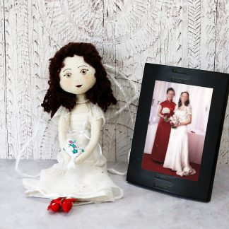 keepsake bride doll beside original photo