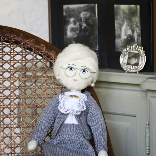 grandma doll in front of her photograph