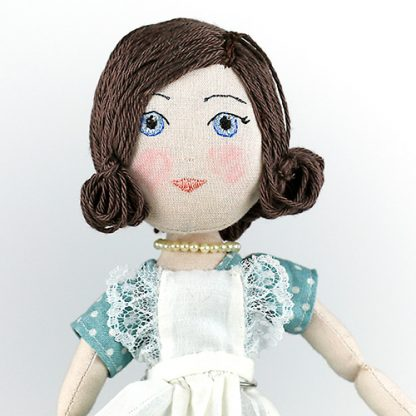 Close-up of housewife doll from 1950s face