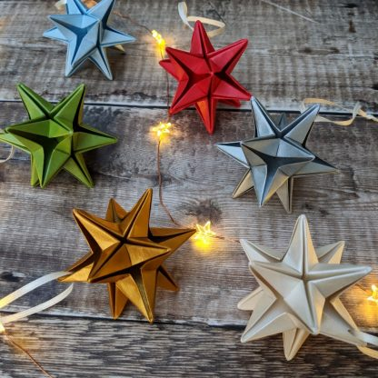 metallic origami paper stars with lights