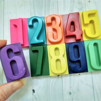 Large individual numbers made from wax crayons