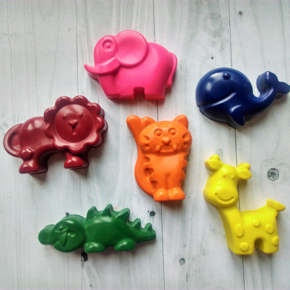 Wax crayons in the shape of a giraffe, elephant, lion, crocodile, whale and tiger