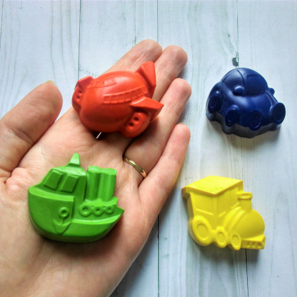 Transport shaped wax crayons in the shape of a boat, train, car and aeroplane