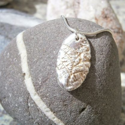 Oval silver pendant and chain with Tree of Life pattern