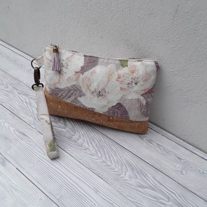 Wristlet clutch bag in natural cork with gold flecks and flowered linen with removable wrist strap and card slots