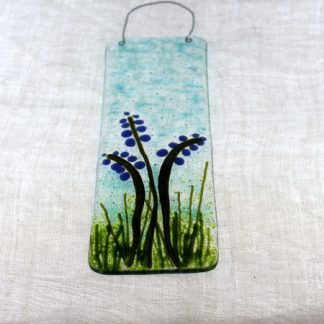 bluebells represented in coloured fused glass