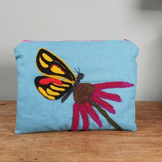 Appliqued blue linen pouch with echinacea and a butterfly
