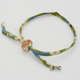 Green liberty cord bracelet with handmade coral and lime green glass bead
