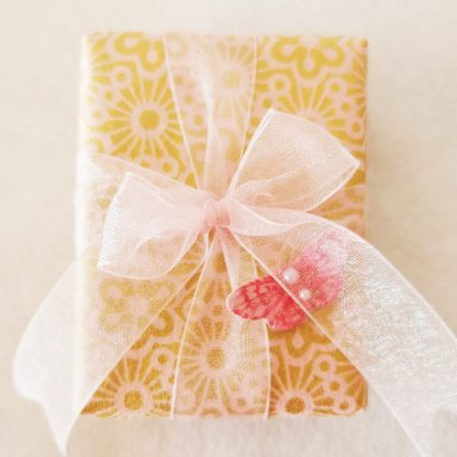 Gift wrapped box with pink bow