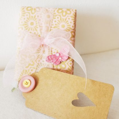 gift wrapped box with ribbon and gift tage