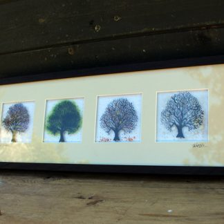 framed set of four glass trees
