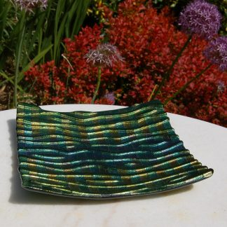 Green, turquoise and gold iridescent fused glass platter with undulating surface pattern