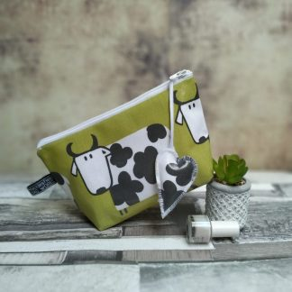 Green oilcloth make-up bag with cow design