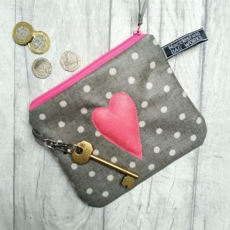 Grey polka dot purse with padded pink heart motif