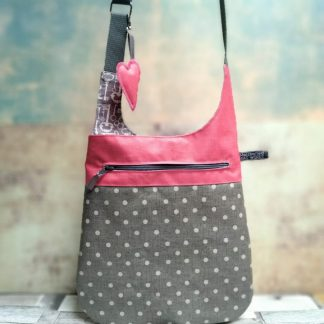 Grey and pink polka dot oilcloth cross body bag