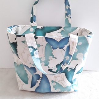 Blue butterflies on a gorgeous handbag with zip fastening.