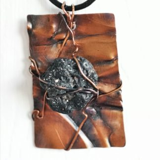 Quirky copper with lava rock