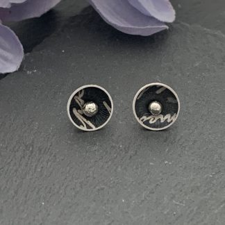 dome aluminium earrings with a black script print and sterling silver post through stud
