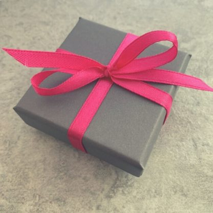 Grey box with pink ribbon