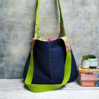 new denim and green handle hobo bag