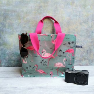 eau de nil and pink flamingo oilcloth tote with vibrant pink lining and handles