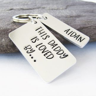 this daddy is loved by hand stamped keyring