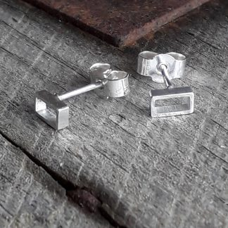 Silver rectangle stud earrings.